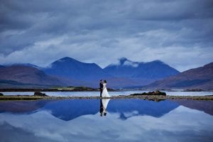 a reflection of a couple on their wedding day