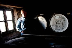 a photograph of jim mcewan at bruichladdich distillery