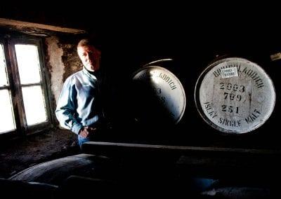 a photograph of jim mcewan at bruichladdich distillery